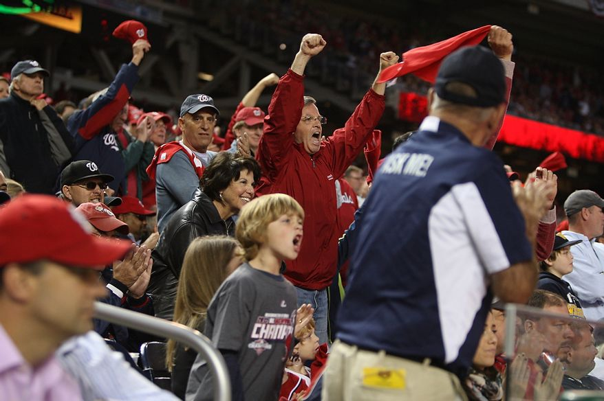 Nats fans cheer as Drew Storen strikes out a Cardinal in the ninth inning of  Game 4 of the National League Division Series between the Washington Nationals and the St. Louis Cardinals at Nationals Park, Thursday, October 11, 2012. (Craig Bisacre/The Washington Times)