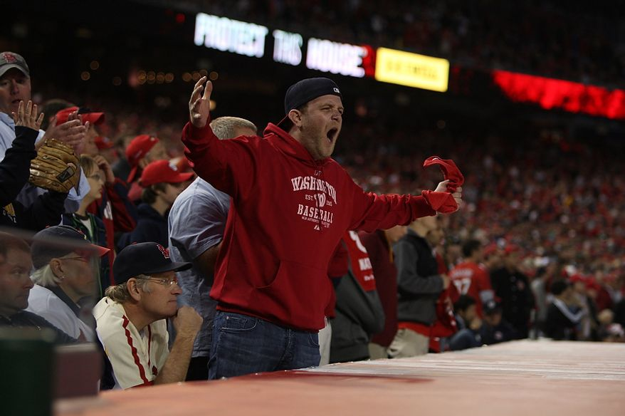 A fan reacts to a Drew Storen pitch being called a ball in the ninth inning of Game 4 of the National League Division Series between the Washington Nationals and the St. Louis Cardinals at Nationals Park, Thursday, October 11, 2012. (Craig Bisacre/The Washington Times)