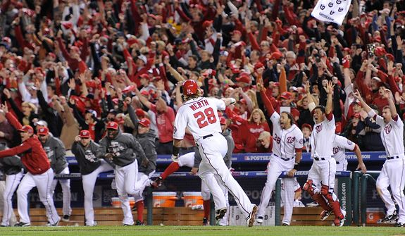 Washington Nationals players go nuts as right fielder Jayson Werth (28) rounds  with a ninth-inning walk-off home run to give the Nats a 2-1 win in Game 4 of the National League Division Series, evening the series at 2-2, between the Washington Nationals and the St. Louis Cardinals at Nationals Park, Thursday, October 11, 2012. (Preston Keres/Special to The Washington Times)