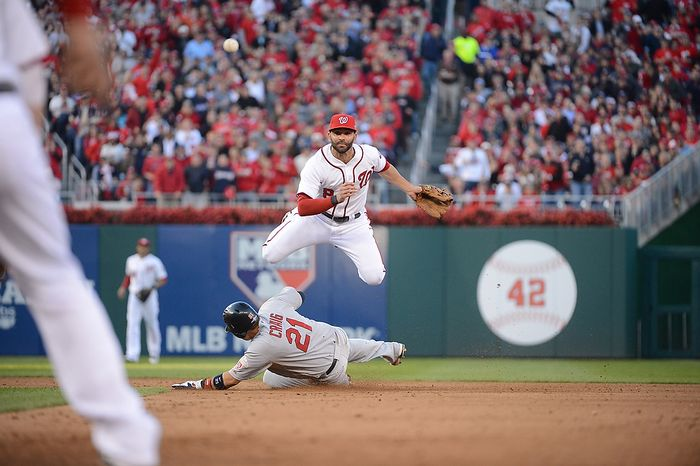 Washington Nationals second baseman Danny Espinosa (8) throws to first after missing a force play at second base in Game 4 of the National League Division Series between the Washington Nationals and the St. Louis Cardinals at Nationals Park, Thursday, October 11, 2012. (Andrew Harnik/The Washington Times)