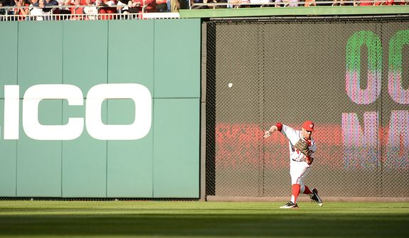 Nationals center fielder Bryce Harper (34) throws home too late on a sacrifice fly ball hit by Cardinals' Carlos Beltran (3) which scores Cardinals shortstop Pete Kozma (38) from third base to tie the game 1-1 during Game 4 of the National League Division Series between the Washington Nationals and the St. Louis Cardinals at Nationals Park, Thursday, October 11, 2012.Game 4 of the National League Division Series between the Washington Nationals and the St. Louis Cardinals at Nationals Park, Thursday, October 11, 2012. (Andrew Harnik/The Washington Times)