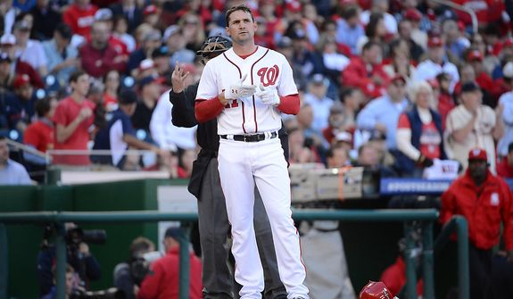 Washington Nationals third baseman Ryan Zimmerman (11) strikes out to end the bottom of the first inning during Game 4 of the National League Division Series between the Washington Nationals and the St. Louis Cardinals at Nationals Park, Thursday, October 11, 2012. (Andrew Harnik/The Washington Times)