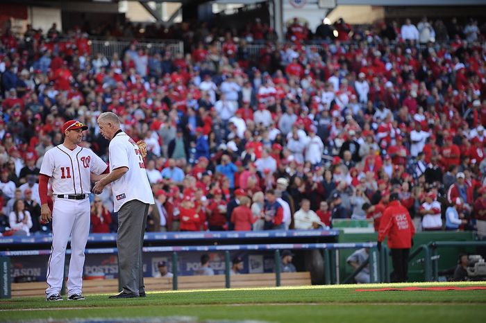Former Washington Senators great Frank Howard throws out the ceremonial first pitch to Nationals third baseman Ryan Zimmerman before Game 4 of the National League Division Series between the Washington Nationals and the St. Louis Cardinals at Nationals Park, Thursday, October 11, 2012. (Andrew Harnik/The Washington Times)