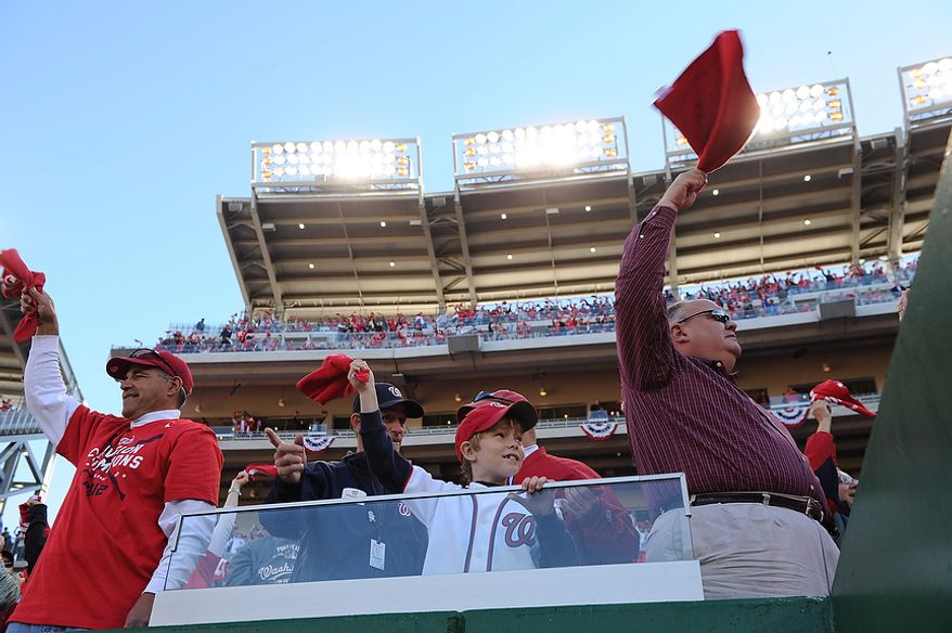 Fans wave their Natitude rally towels as the players are introduced before Game 4 of the National League Division Series between the Washington Nationals and the St. Louis Cardinals at Nationals Park, Thursday, October 11, 2012. (Andrew Harnik/The Washington Times)