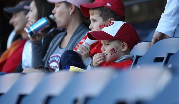 Cal Banasvewski [cq], 3, eats popcorn while waiting to watch his first ever Nationals game; Game 4 of the National League Division Series between the Washington Nationals and the St. Louis Cardinals at Nationals Park, Thursday, October 11, 2012. (Craig Bisacre/The Washington Times)