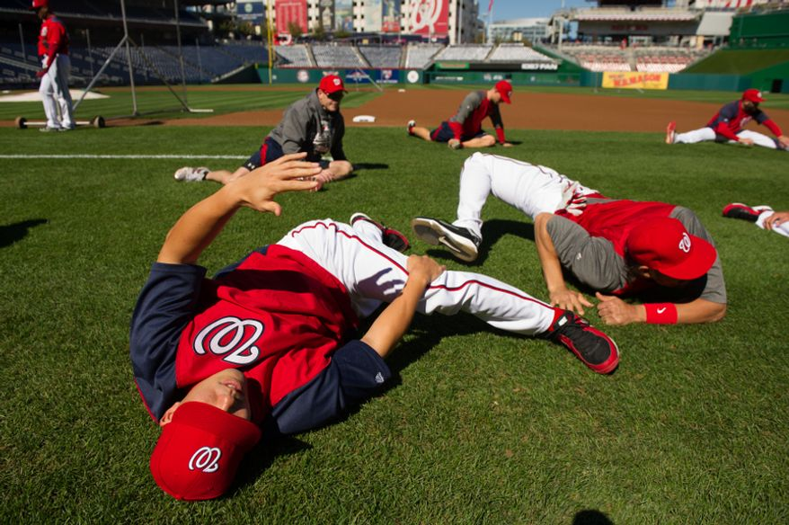 The Washington Nationals warm up before playing the St. Louis Cardinals in game four of the National League Division Series at Nationals Park, Washington, D.C., Thursday, October 11, 2012. (Andrew Harnik/The Washington Times)