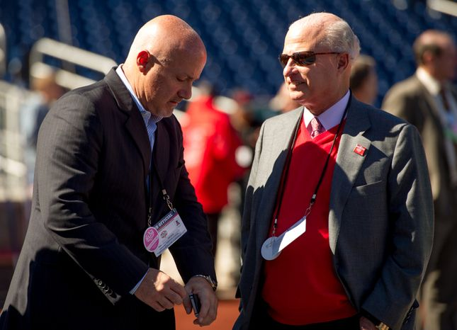 Washington Nationals General Manager Mike Rizo, left, talks with owner Mark Lerner, right, before the Washington Nationals play the St. Louis Cardinals in game four of the National League Division Series at Nationals Park, Washington, D.C., Thursday, October 11, 2012. (Andrew Harnik/The Washington Times)