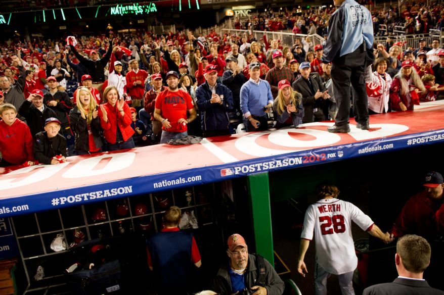 Washington Nationals right fielder Jayson Werth (28) heads to the locker room after hitting a walk off home run in the bottom of the ninth inning to beat the St. Louis Cardinals 2-1 in game four of the National League Division Series at Nationals Park, Washington, D.C., Thursday, October 11, 2012. (Andrew Harnik/The Washington Times)