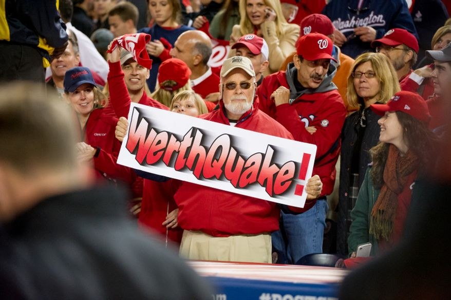A fan holds up a poster as Washington Nationals right fielder Jayson Werth (28) hits a walk off home run in the bottom of the ninth inning to beat the St. Louis Cardinals 2-1 in game four of the National League Division Series at Nationals Park, Washington, D.C., Thursday, October 11, 2012. (Andrew Harnik/The Washington Times)