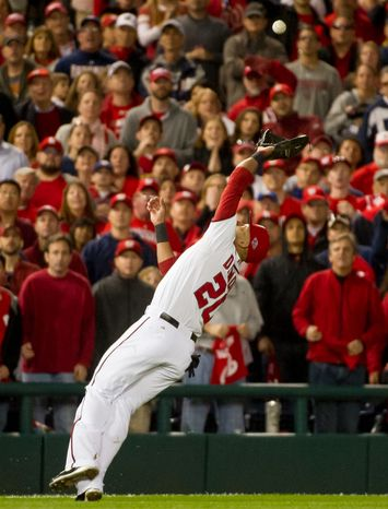 Washington Nationals shortstop Ian Desmond (20) makes a diving catch on a ball popped up by St. Louis Cardinals first baseman Matt Carpenter (13) for the final out of the top of the ninth inning as the Washington Nationals play the St. Louis Cardinals in game four of the National League Division Series at Nationals Park, Washington, D.C., Thursday, October 11, 2012. (Andrew Harnik/The Washington Times)