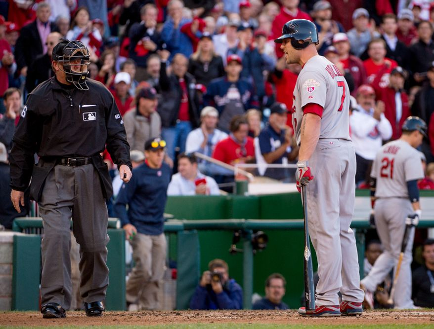 St. Louis Cardinals left fielder Matt Holliday (7) argues a call after he is struck out at the top of the third as the Washington Nationals play the St. Louis Cardinals in game four of the National League Division Series at Nationals Park, Washington, D.C., Thursday, October 11, 2012. (Andrew Harnik/The Washington Times)