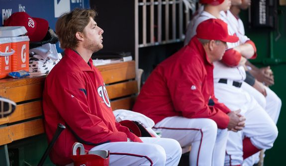 Washington Nationals starting pitcher Ross Detwiler (48) sits on the bench during the fifth inning as the Washington Nationals play the St. Louis Cardinals in game four of the National League Division Series at Nationals Park, Washington, D.C., Thursday, October 11, 2012. (Andrew Harnik/The Washington Times)