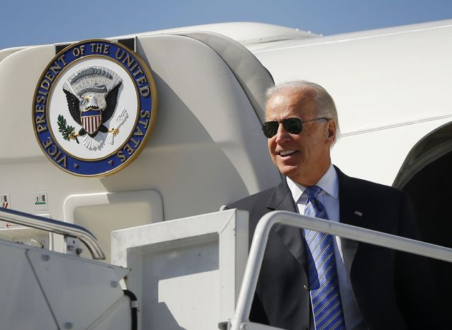 ** FILE ** Vice President Joseph R. Biden walks out of Air Force Two upon his arrival on Oct. 11, 2012, at Blue Grass Airport in Lexington, Ky., for the vice presidential debate. (Associated Press)
