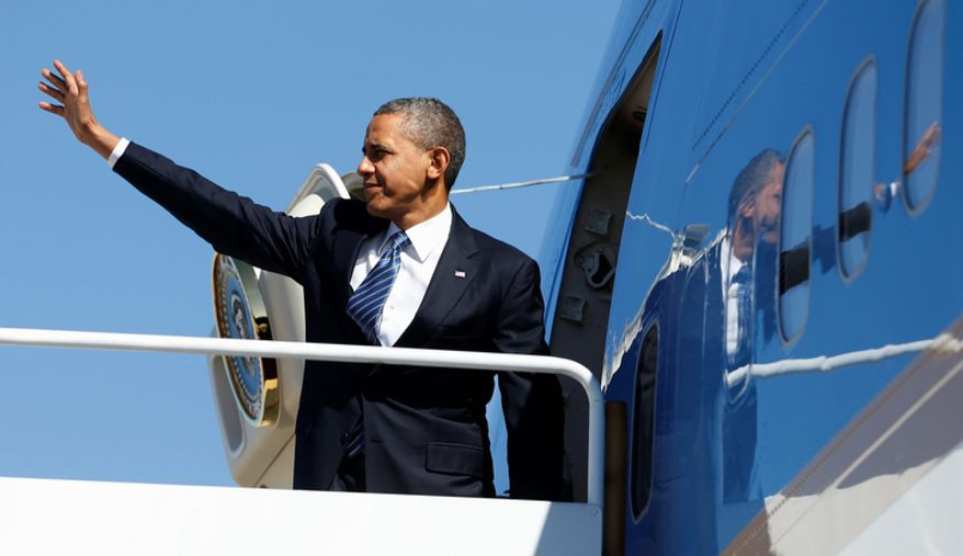 President Obama waves Oct. 11, 2012, as he boards Air Force One at Andrews Air Force Base, Md., en route to Florida. (Associated Press)