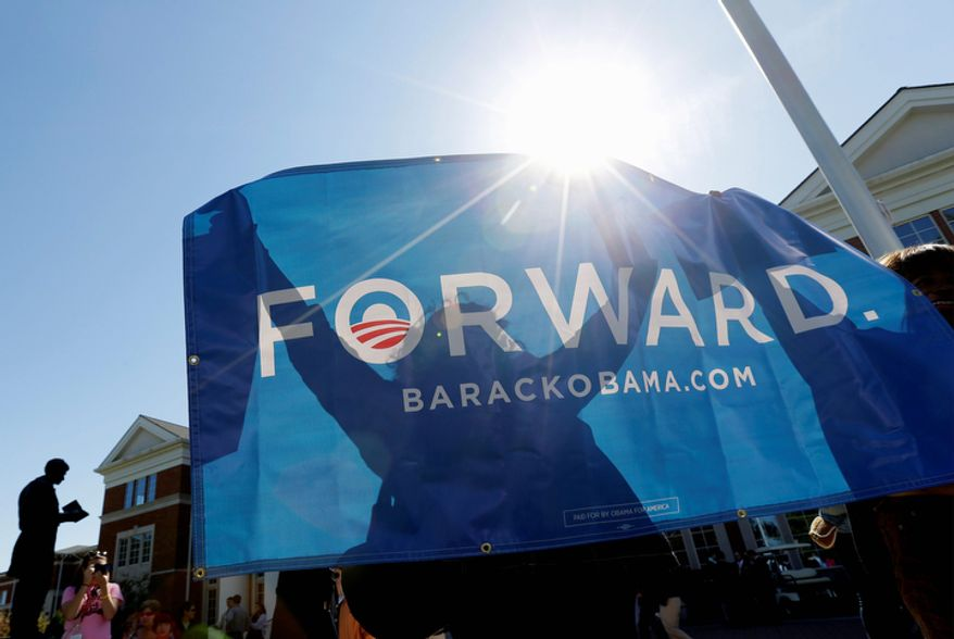 Supporters hold an Obama banner on Oct. 11, 2012, at Centre College in Danville, Ky., site of the vice presidential debate. Vice President Joseph R. Biden was to face Republican vice presidential candidate Paul Ryan later that day. (Associated Press)
