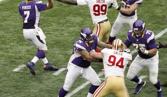Minnesota Vikings quarterback Christian Ponder (7) is pressured by San Francisco 49ers outside linebacker Aldon Smith (99) while throwing a pass during the second half of an NFL football game Sunday, Sept. 23, 2012, in Minneapolis. (AP Photo/Genevieve Ross)
