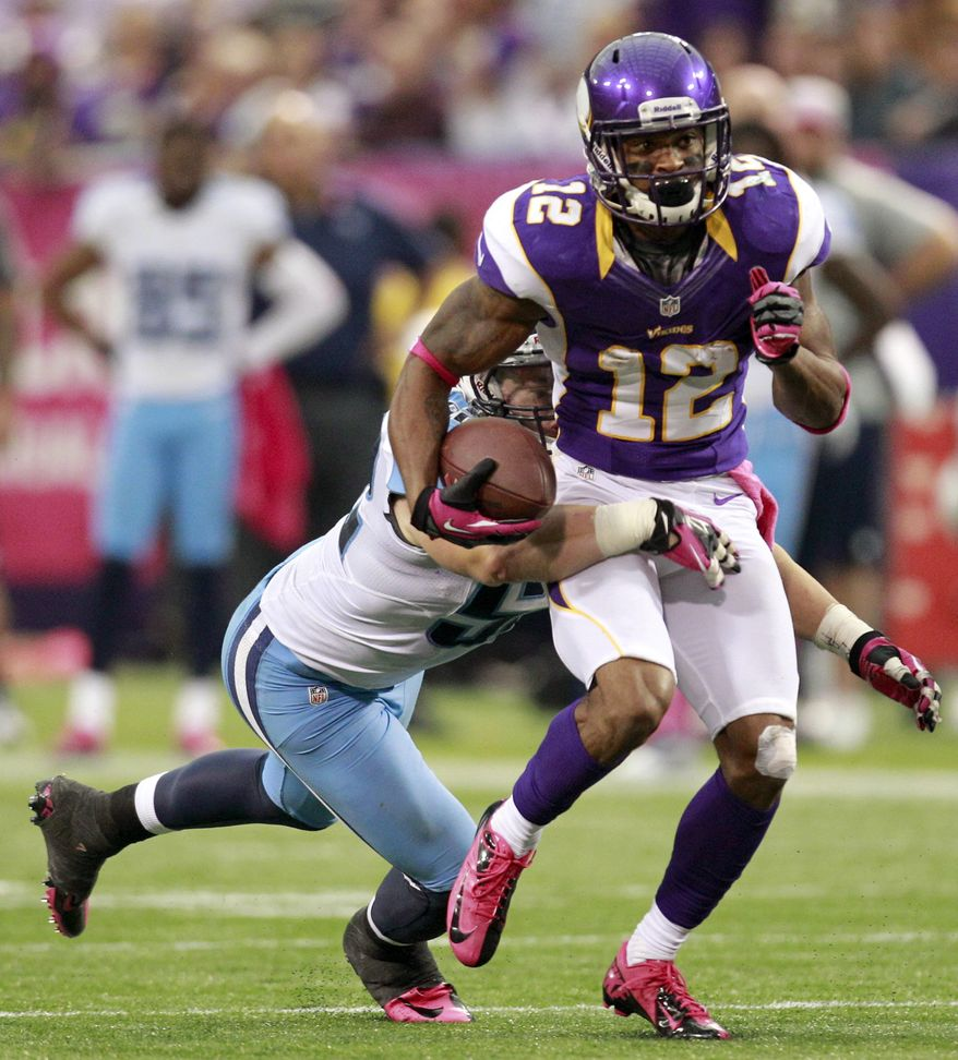 Minnesota Vikings wide receiver Percy Harvin (12) breaks a tackle by Tennessee Titans linebacker Colin McCarthy, left, during the first half of an NFL football game on Sunday, Oct. 7, 2012, in Minneapolis. (AP Photo/Genevieve Ross)