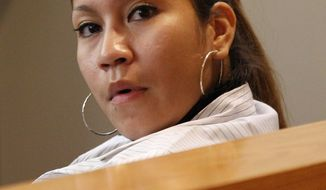 Elizabeth Escalona, 23, sits in a Dallas courtroom during a sentencing hearing on Oct. 8, 2012, after pleading guilty in July to injury to a child. A doctor testified that the Texas mother glued her 2-year-old daughter's hands to a wall and beat the toddler so badly that she suffered significant brain trauma and bleeding inside her skull. (Associated Press)