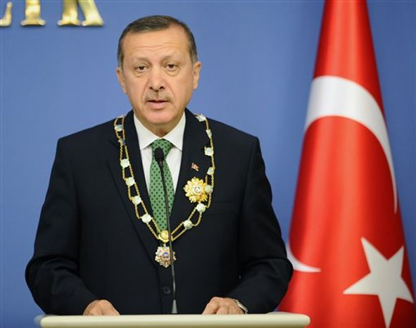Turkish Prime Minister Recep Tayyip Erdogan speaks during a news conference with Kazakh President Nursultan Nazarbayev, unseen, in Ankara, Turkey, Thursday, Oct. 11, 2012. Erdogan said the Syrian passenger plane intercepted on its way from Moscow to Damascus was carrying military equipment and ammunition to Syria. (AP Photo)