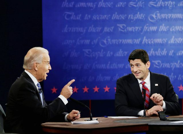 Vice President Joe Biden, left, and Republican vice presidential nominee, Rep. Paul Ryan, of Wisconsin, challenge each other during the vice presidential debate Thursday, Oct. 11, 2012, at Centre College in Danville, Ky. (AP Photo/Eric Gay)