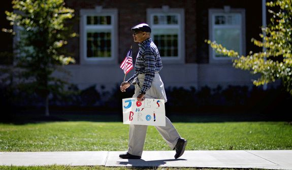Bert Christian of Louisville, Ky., carries a sign in support of Vice President Joe Biden ahead of the vice presidential debate between Biden and Republican vice presidential candidate, Rep. Paul Ryan, R-Wis.,. (AP Photo/David Goldman)