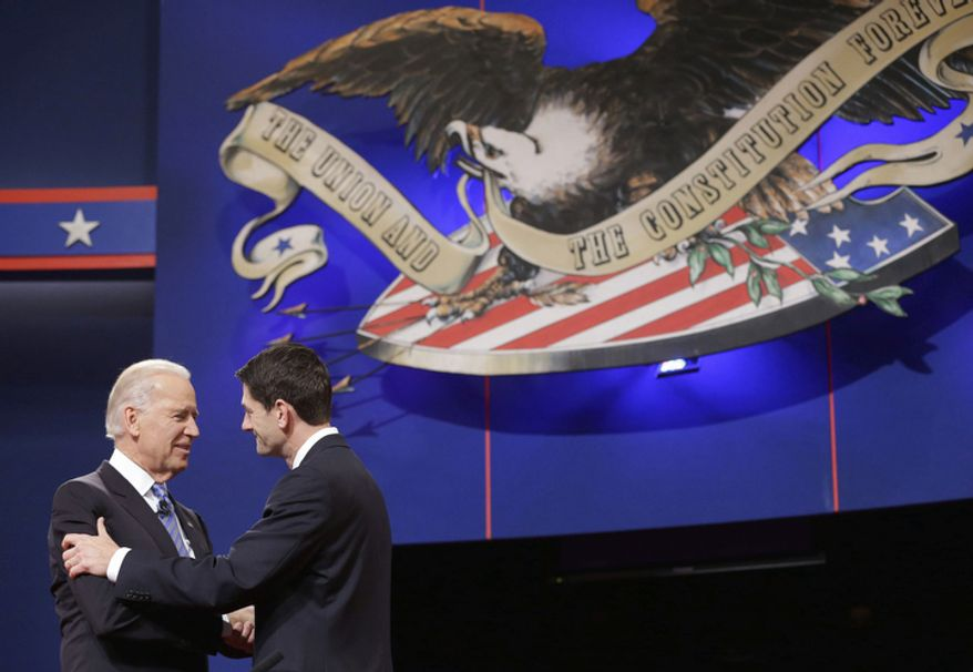 Vice President Joe Biden and Republican vice presidential candidate, Rep. Paul Ryan, R-Wis., shake hands before the start of the vice presidential debate. (AP Photo/Pablo Martinez Monsivais)