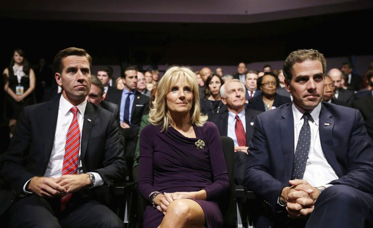 Jill Biden, center, wife of Vice President Joe Biden, sits with her sons Beau Biden, left, and Hunter Biden, right, before the start of the vice presidential debate, at Centre College in Danville, Ky. (AP Photo/Pablo Martinez Monsivais)