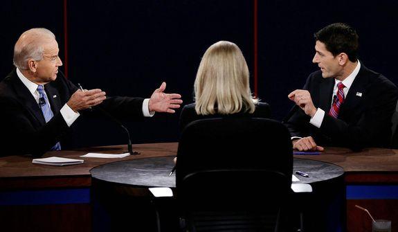 Vice President Joe Biden and Republican vice presidential nominee Rep. Paul Ryan of Wisconsin spar during the vice presidential debate. (AP Photo/Charlie Neibergall)