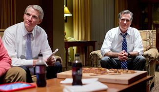 ** FILE ** Republican presidential candidate, former Massachusetts Gov. Mitt Romney, right, watches the vice presidential debate with Sen. Rob Portman, R- Ohio, left, in his hotel room in Asheville, N.C.  (AP Photo/ Evan Vucci)