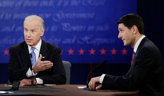Vice President Joe Biden, left, and Republican vice presidential nominee Paul Ryan, of Wisconsin, speak during the vice presidential debate. (AP Photo/David Goldman)