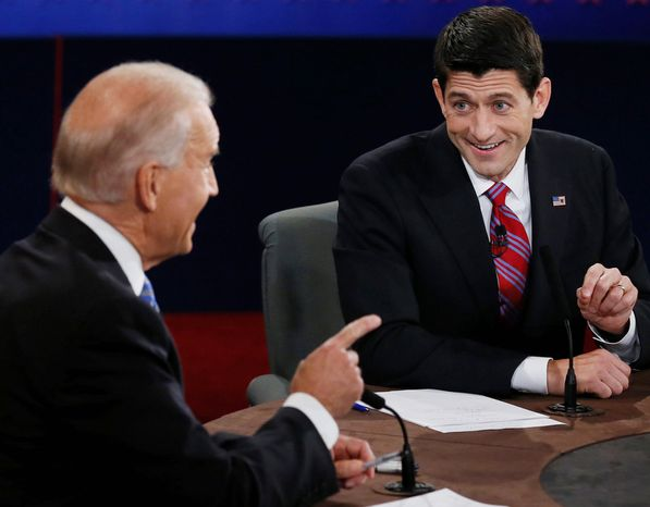 Vice President Joe Biden and Republican vice presidential nominee Rep. Paul Ryan of Wisconsin participate in the vice presidential debate at Centre College. (AP Photo/Pool-Rick Wilking)