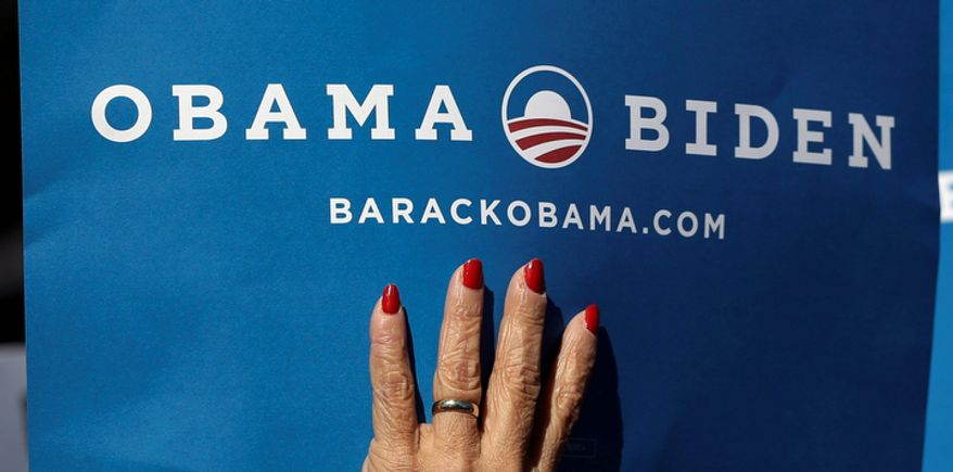 A supporters holds a sign for President Obama and Vice President Biden at Centre College in Danville, Ky., site of the vice presidential debate, on Oct. 11, 2012. Biden will face Republican vice presidential candidate Paul Ryan. (Associated Press)