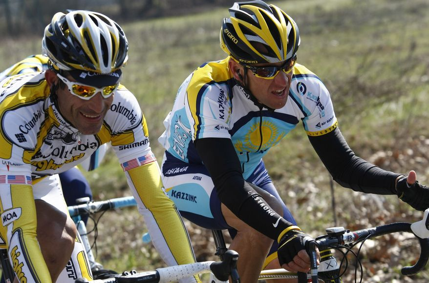 """FILE - This March 21, 2009 file photo shows Lance Armstrong, of the United States, beside fellow countryman George Hincapie, left, during the Milan-San Remo cycling classic in San Remo, Italy. The U.S. Anti-Doping Agency says 11 of Lance Armstrong's former teammates testified against him in its investigation of the cyclist, revealing """"the most sophisticated, professionalized and successful doping program that sport has ever seen."""" (AP Photo/Alessandro Trovati)"""