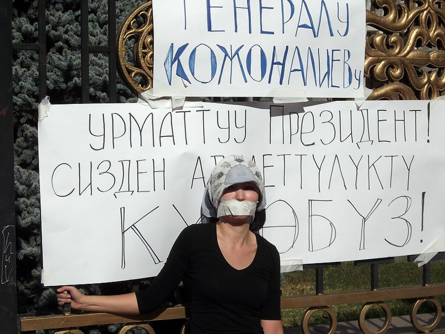 Daniya Kozhonaliyev, daugther of former military prosecutor Kubatbek Kozhonaliyev who was arrested last week in connection with protests that the Kyrgz government have branded at attempted coup, on hunger strike outside the White House government building in Bishkek. October 10, 2012. (Mattia Beggi/Special to The Washington Times)