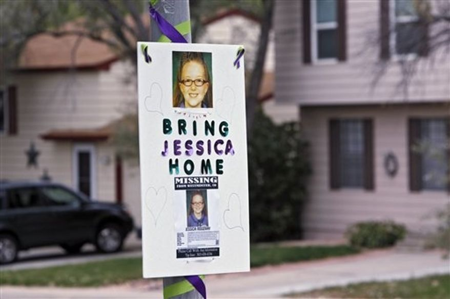 A missing person sign is posted on a lamp post near the home of 10-year-old Jessica Ridgeway where police continue to search for the missing girl in Westminster, Colo., on Wednesday, Oct. 10, 2012. The youngster has been missing since she left her home Friday morning on her way to school. (AP Photo/Ed Andrieski)