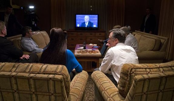 Republican presidential candidate, former Massachusetts Gov. Mitt Romney, right, watches the vice presidential debate in his hotel room on Thursday, Oct. 11, 2012 in Asheville, N.C.  (AP Photo/ Evan Vucci)