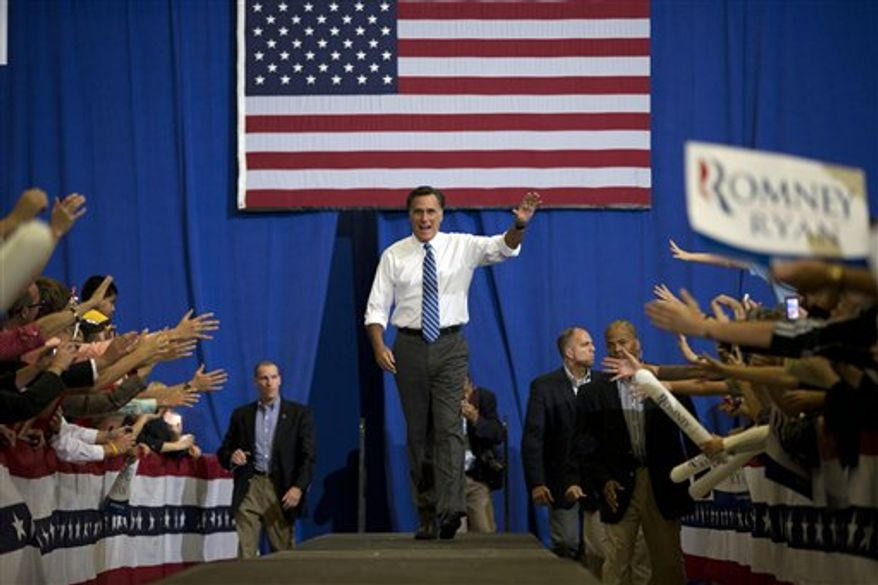 Republican presidential candidate, former Massachusetts Gov. Mitt Romney waves as he arrives for a campaign rally at the U.S. Cellular Center on Thursday, Oct. 11, 2012 in Asheville, N.C.  (AP Photo/ Evan Vucci)