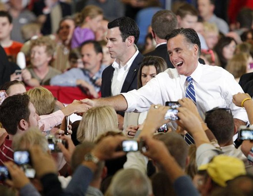 Republican presidential candidate, former Massachusetts Gov. Mitt Romney shakes hands with supporters at a campaign rally at the U.S. Cellular Center on Thursday, Oct. 11, 2012, in Asheville, N.C. (AP Photo/Matt Rose)