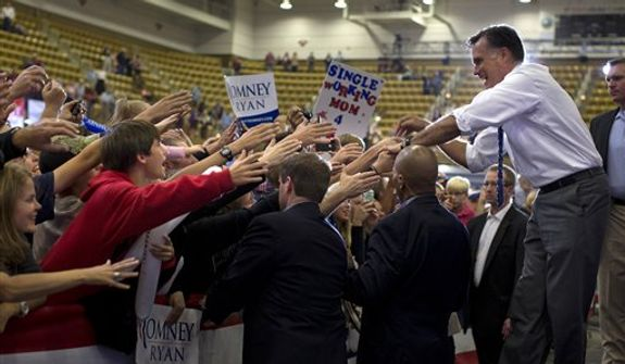 Republican presidential candidate, former Massachusetts Gov. Mitt Romney shakes hands during a campaign rally at the U.S. Cellular Center on Thursday, Oct. 11, 2012 in Asheville, N.C.  (AP Photo/ Evan Vucci)