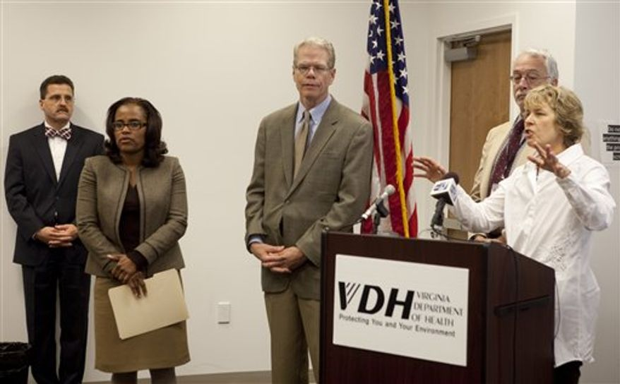 Dr. Molly O'Dell, right, health director of the New River Valley Health District, addresses a press conference on Friday, Oct. 5, 2012 in Roanoke, Va., concerning the recent fungal menigitis outbreak investigation tied to tainted injections. Other health care officials participating are, from the left; LewisGale Regional Health System CEO Victor Giovanetti, Director of the Roanoke-Alleghany Health Department Dr. Stephanie Harper, Chief Medical Officer for LewisGale Regional Health System Dr. Gary Winfield, Dr. Thomas Kerkering, Infectious Disease, Carilion Clinic. Public health officials in Virginia say the number of suspected cases of a rare and potentially deadly outbreak of meningitis has increased to five. The state has recorded one death linked to a fungal meningitis outbreak.(AP Photo/The Roanoke Times, Stephanie Klein-Davis)