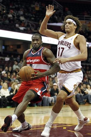 Washington Wizards' Martell Webster (9) drives past Cleveland Cavaliers' Anderson Varejao (17) during the first quarter of an NBA preseason basketball game Saturday, Oct. 13, 2012, in Cleveland. (AP Photo/Tony Dejak)