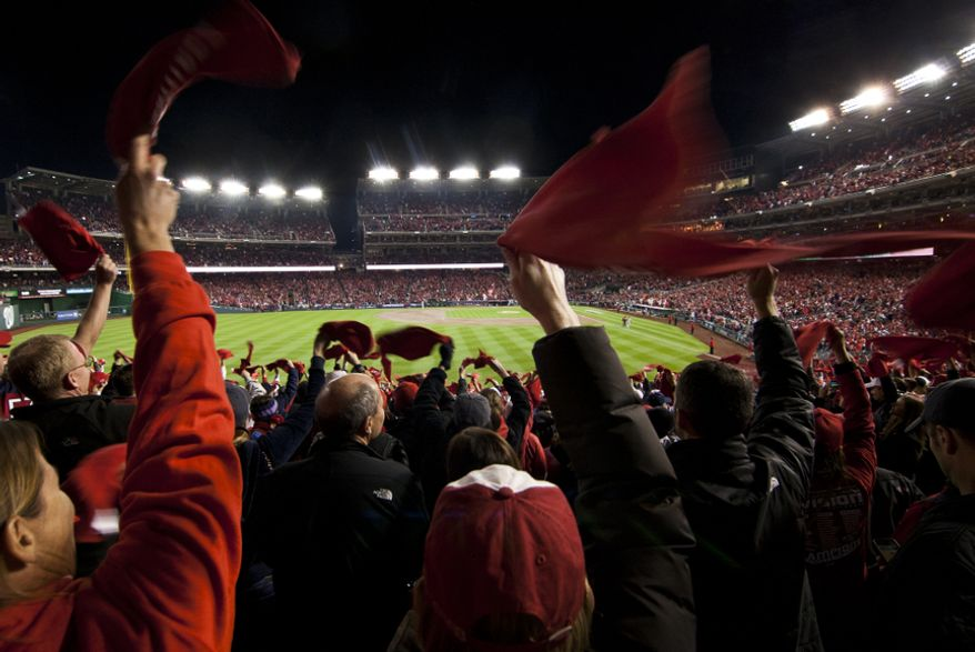 Fans wave their rally towels before Game 5 of the National League Division Series between the Washington Nationals and the St. Louis Cardinals at Nationals Park, Thursday, October 11, 2012. (Craig Bisacre/The Washington Times)