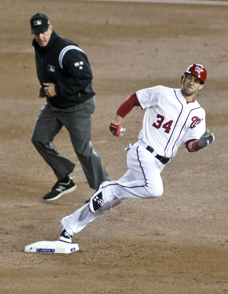 Washington Nationals center fielder Bryce Harper (34) rounds second before safely siding into third in the first inning in Game 5 of the National League Division Series between the Washington Nationals and the St. Louis Cardinals at Nationals Park, Thursday, October 11, 2012. (Craig Bisacre/The Washington Times)