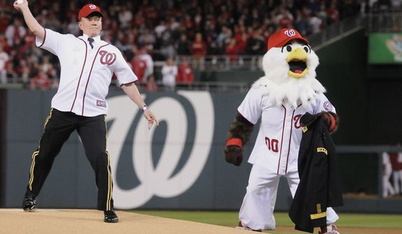 Army Gen. Martin E. Dempsey, chairman of the Joint Chiefs of Staff, throws out the first pitch before Game 5 of the National League Division Series between the Washington Nationals and the St. Louis Cardinals at Nationals Park, Friday, October 12, 2012. (Preston Keres/Special to The Washington Times)