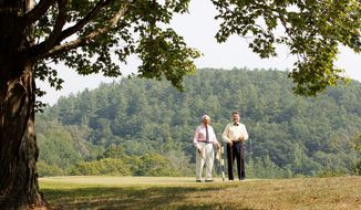 Lewis Keller Sr. (left) and Bill Sharp stand on the ninth hole at Oakhurst links course in West Virginia, which will be bought by the nearby Greenbrier resort. (The Associated Press)