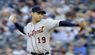 Detroit Tigers' Anibal Sanchez throws in the first inning during Game 2 of the American League championship series against the New York Yankees Sunday, Oct. 14, 2012, in New York. (AP Photo/Matt Slocum)