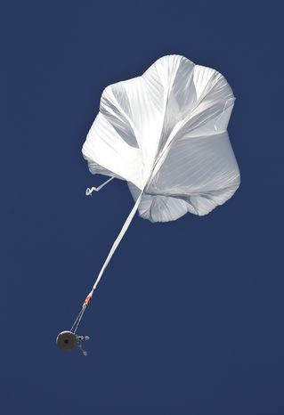 The capsule and attached helium balloon carrying Felix Baumgartner lifts off as he attempts to break the speed of sound during a jump from an altitude of 120,000 feet on Sunday, Oct. 14, 2012, in Roswell, N.M. (AP Photo/Ross D. Franklin)