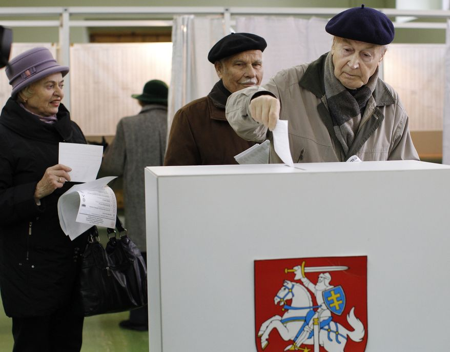 A Lithuanian voter casts his ballot at a polling station in Vilnius, Lithuania, the capital, on Sunday, Oct. 14, 2012. (AP Photo/Mindaugas Kulbis)