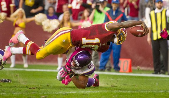 Washington Redskins quarterback Robert Griffin III (10) takes it in himself for a 7 yard touchdown run in the third quarter to put the Washington Redskins up 24-9 as the Washington Redskins play the Minnesota Vikings at FedEx Field, Landover, Md., Sunday, October 14, 2012. (Andrew Harnik/The Washington Times)