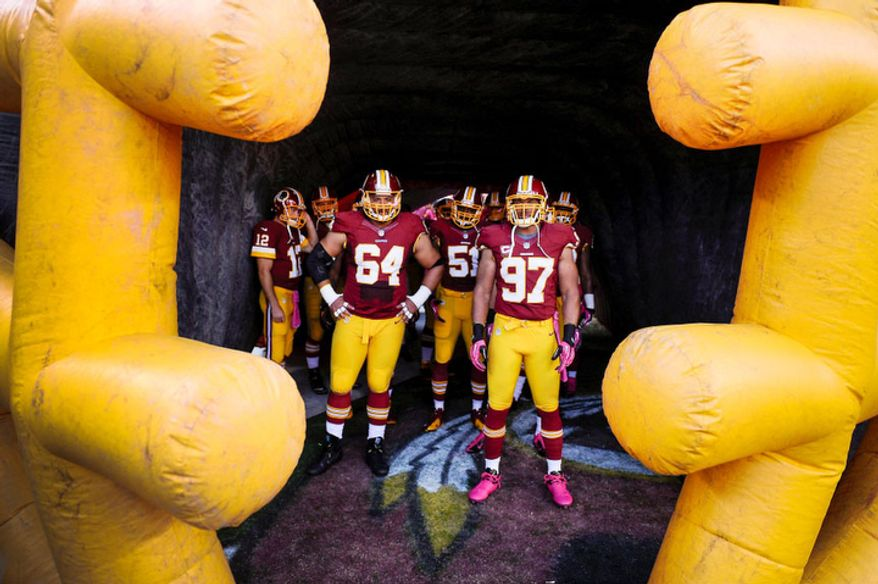 The Redskins wait in the tunnel before the pregame introductions at FedEx Field. (Preston Keres/Special to The Washington Times)